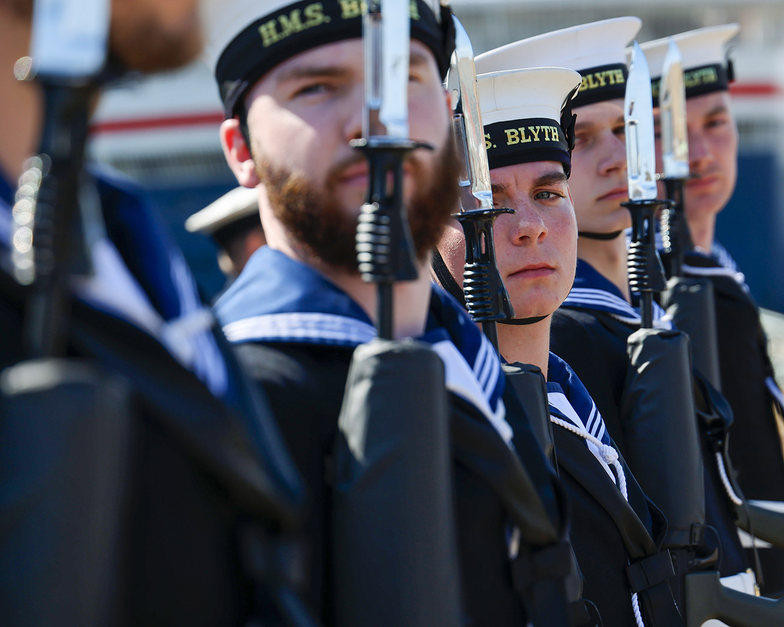 Sailors from HMS Blyth form a guard of honour